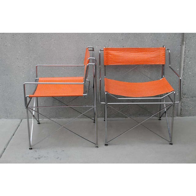 """Pair of steel and faux alligator covered chairs. Each chair measures: 25"""" wide, 22"""" deep and 29.5"""" high. Seat height is 17""""."""