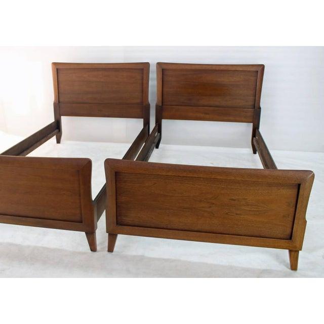 Pair of Mid-Century Modern walnut Henredon beds. Beautiful walnut wood grain nice Mid-Century Modern design.