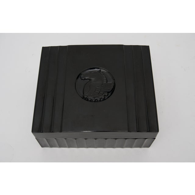 This stylish large-scale American Art Deco bakelite box dates to the late 1920s to the early 1930s. The piece is detailed...