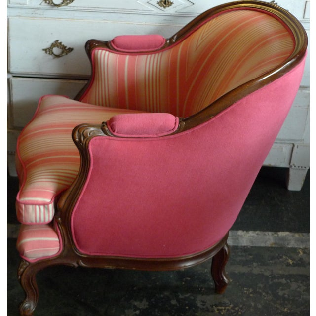 This is a 19th century walnut Bergere armchair that we have reupholstered and covered with some new fabric.