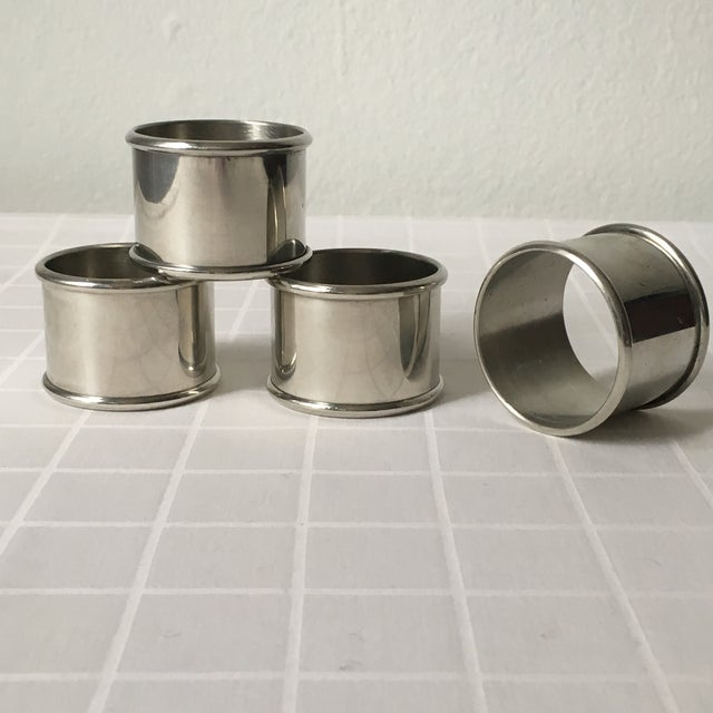 This set of four pewter napkins rings was made by Kirk Stieff Company of Baltimore, MD. The plain surfaces can be engraved...