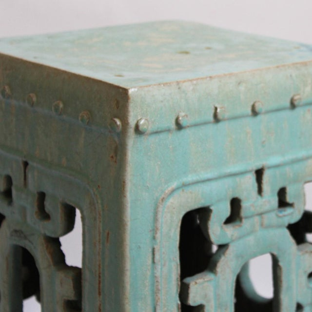 Turquoise ceramic garden stool. Great for use outdoors for a colorful side table, extra seating, or a stool.