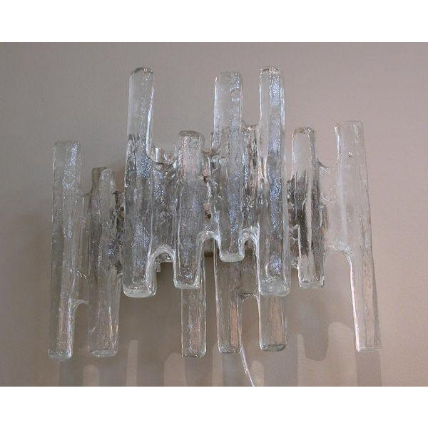 """A shimmering pair of Austrian 1960's clear """"ice block"""" glass wall sconces by J.T. Kalmar; each with chrome back plate..."""