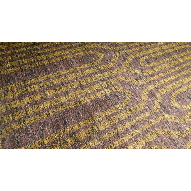 Modern hand-Made flat weave from India. Material: Sari Silk blend Primary Color: Mustard Secondary Color: Grape