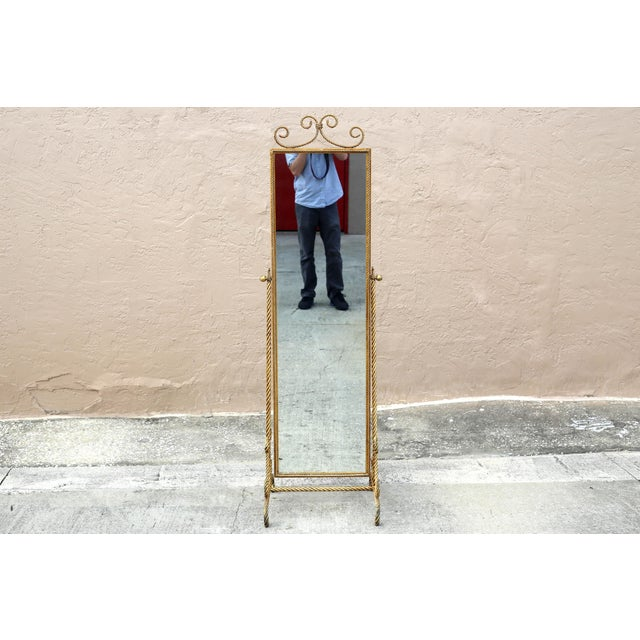 """A Hollywood Regency wrought iron rope floor mirror, covered in gold gilt. Made in Italy. Heavy and gorgeous! 67"""" tall x..."""
