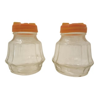 Glass Salt And Pepper With Orange Tops For Sale