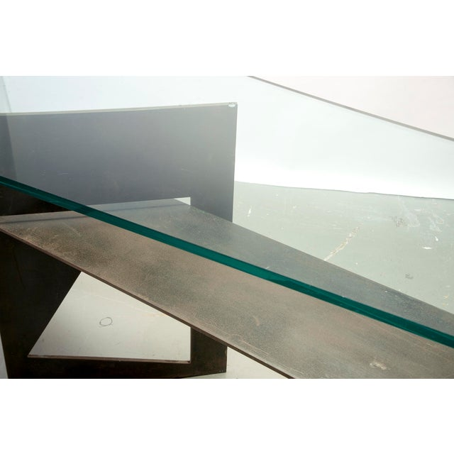 Found in Italy, this circa 1970s brutalist style console has an iron base and thick glass top with polished edges. Table...