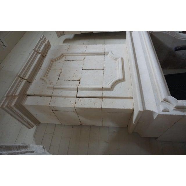 This antique limestone mantel originates from France, circa 1600s. Measurements: 59.75'' W x 30.5'' D x 110.75'' H...