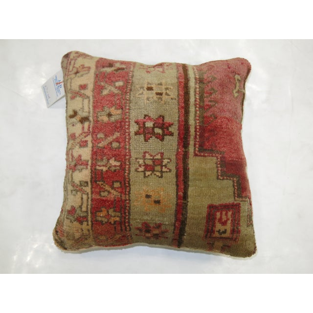 Pillow made from a vintage turkish rug with cotton back. Zipper closure and foam insert provided. 15'' x 16''