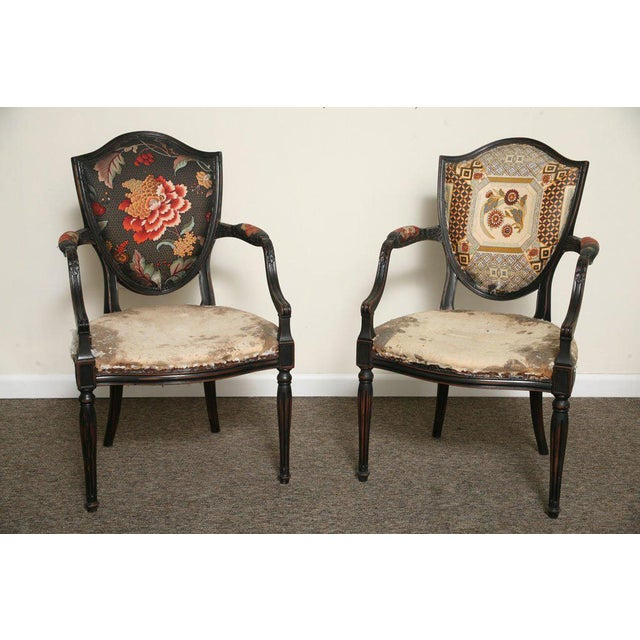 Pair of Neoclassical Elegant Wooden Armchairs from the 1920. They have fabric upholstery which has visible signs of wear...