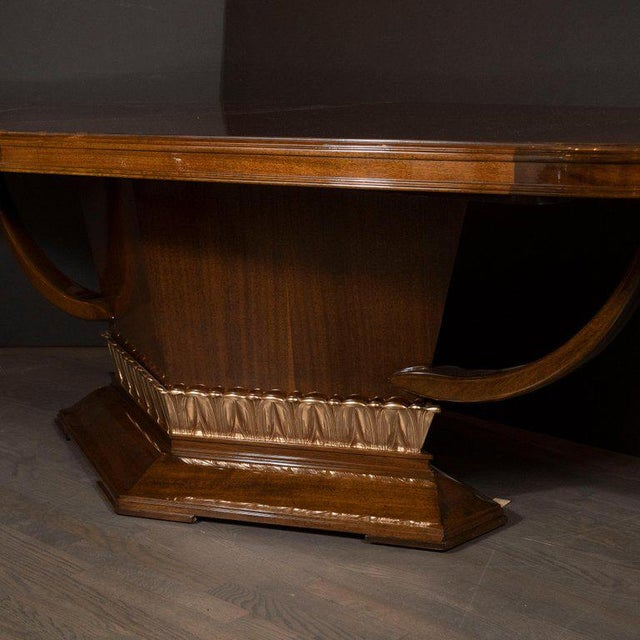 This stunning high style Art Deco dining table was realized in France, circa 1940. It features a bookmatched mahogany...