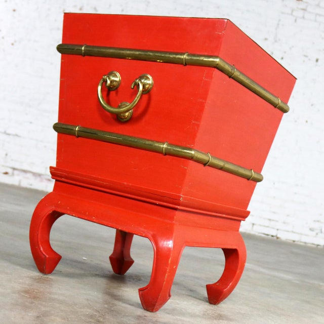 Handsome Chinese red lacquer and brass ice chest, planter, accent table with galvanized insert and lid on hoof foot style...