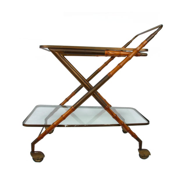 A 1950, original Italian serving table or bar cart by Cesare Lacca. Made with brass and gorgeous bamboo details. Comes...