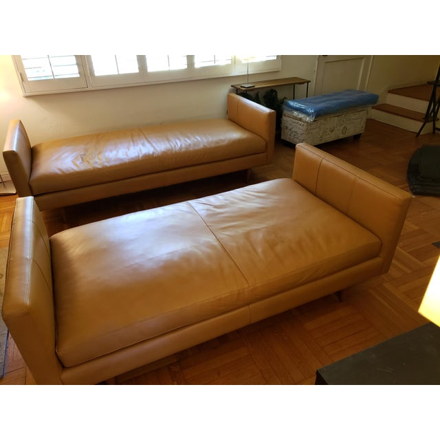 Two tan leather couches, one slightly shorter. Five years old, good shape. Classic design.