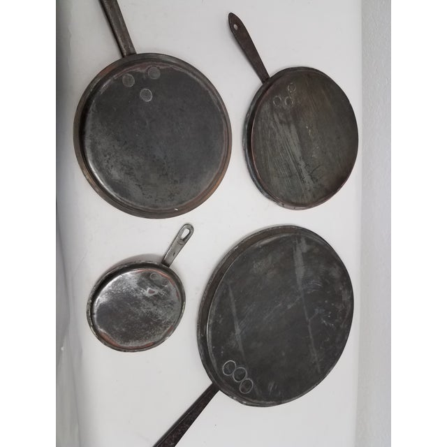 Four Antique English Copper Pan Lids We thought these lids would be great on a kitchen wall. The four different sizes were...