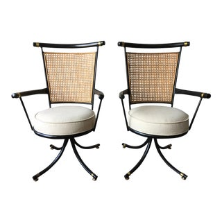 Mid century Black Brass and Cane Swivel Chairs - a Pair