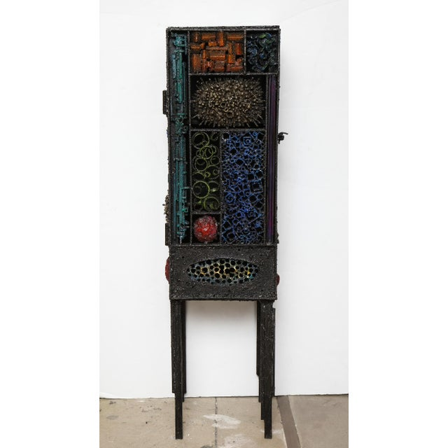 """Segment Cabinet #2,"" a sculptural work in torch-cut, dyed steel with fused bronze and glass enamel, by American artist..."