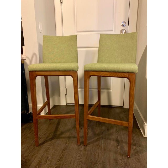 Pair of vintage mid century modern wood bar stools for sale. Legs are solid wood. The wood and fabric are in great shape!...