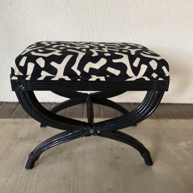 Black bamboo bench with designer fabric. Sleek design with a shiny black finish.