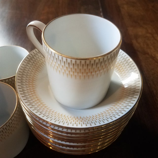 """(10) Espresso Cups and Saucers with Tannish-Orange, Brown and gold trim. Rare pattern and shape. Cups: 2.25""""R x 3""""""""W with..."""