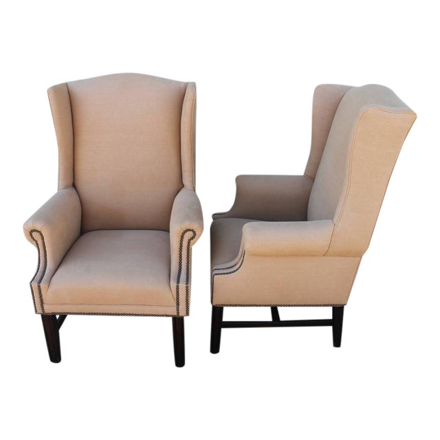 These wing chairs are super handsome and very comfortable. The color of the linen looks great with natural old patina wood...