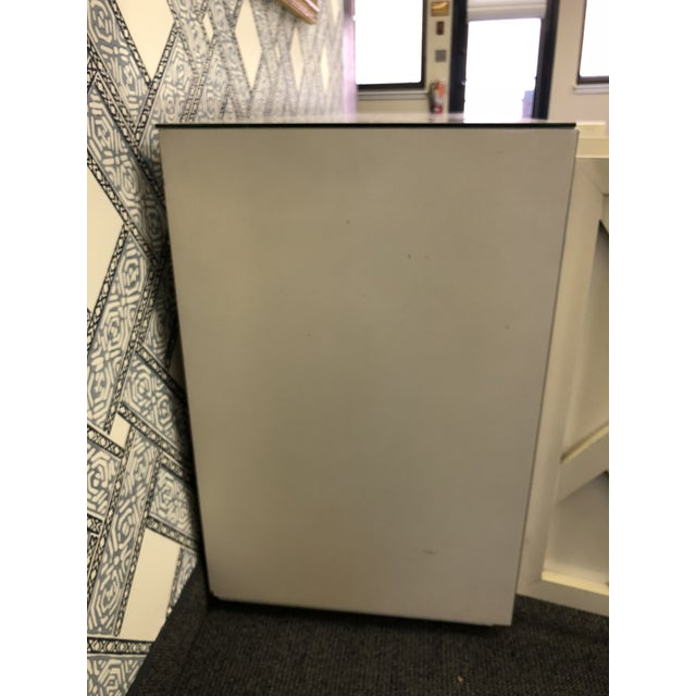 An eye-catching piece that has more storage than you can imagine! The mirror top and front Chinese chippendale cream-...