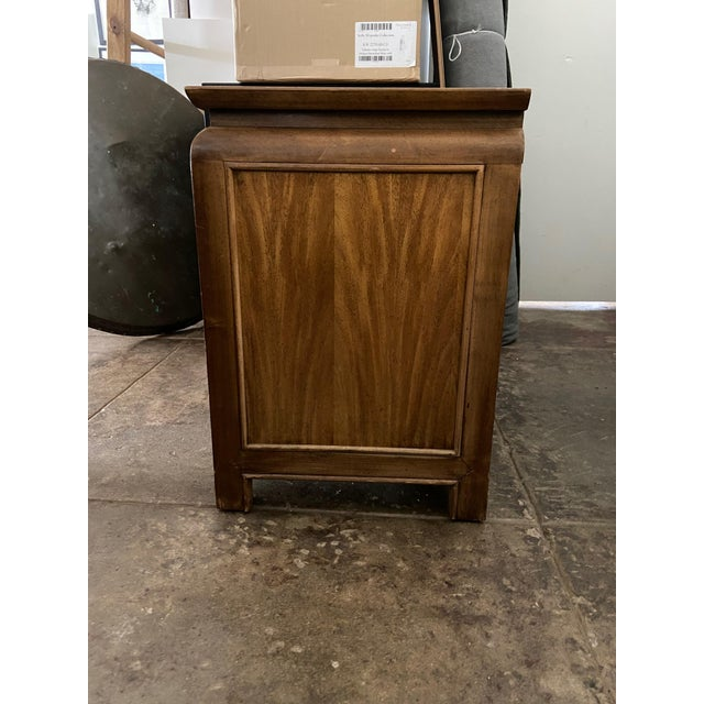 Century Furniture crafted this vintage nightstand with stunning burlwood veneer and brass hardware in the mid-century...