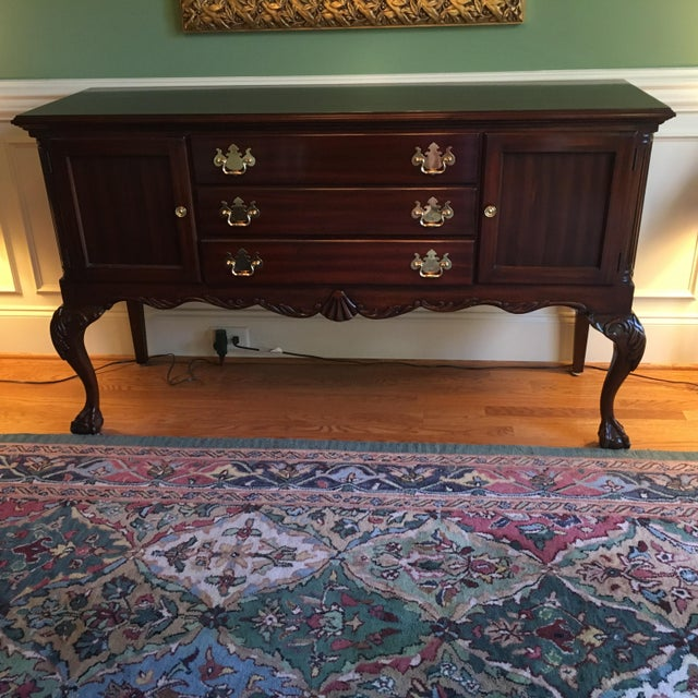 Offering a beautiful Queen Anne mahogany sideboard. 3 drawers for storage (deep enough for flatware storage box) and 2...