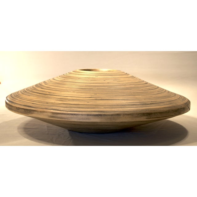 From Thailand, this piece can function both as a vase for dry arrangements or a stand-alone piece. Sculpted from spun...