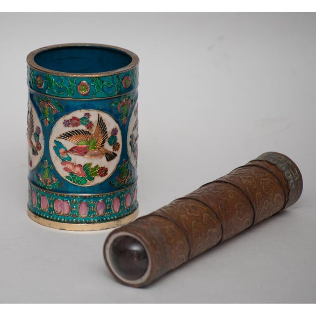 A set of Vintage Peking Cloisonne Brush Pot or pens holder and Vintage Brass Kaleidoscope. The Brush Pot is depicting...