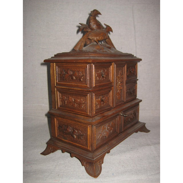 Very pretty exemple of Black Forest carving for this lovely jewelry box , very well made can be open in different ways , 5...
