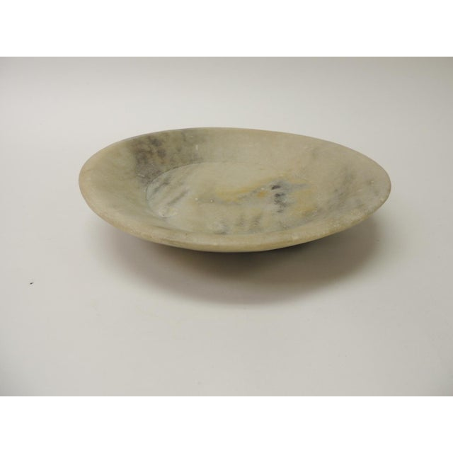 Vintage hand carved Alabaster round decorative serving bowl. In shades of yellow, green and grey. Size: 11.5 x 2.5.