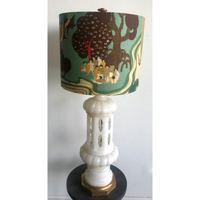 Hand carved Italian Alabaster table lamp with arabesque Moroccan design and gold leaf wood base. Custom linen shade made...