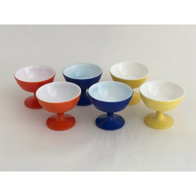 Set of six midcentury footed glass parfait glasses in primary colors with white interiors. Made in the 1970s.