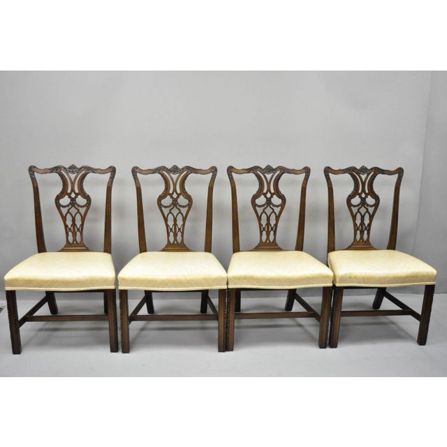 Set of 4 Antique Mahogany Pagoda Carved Chinese Chippendale Style Dining Chairs. Listing includes pagoda carved top rail,...