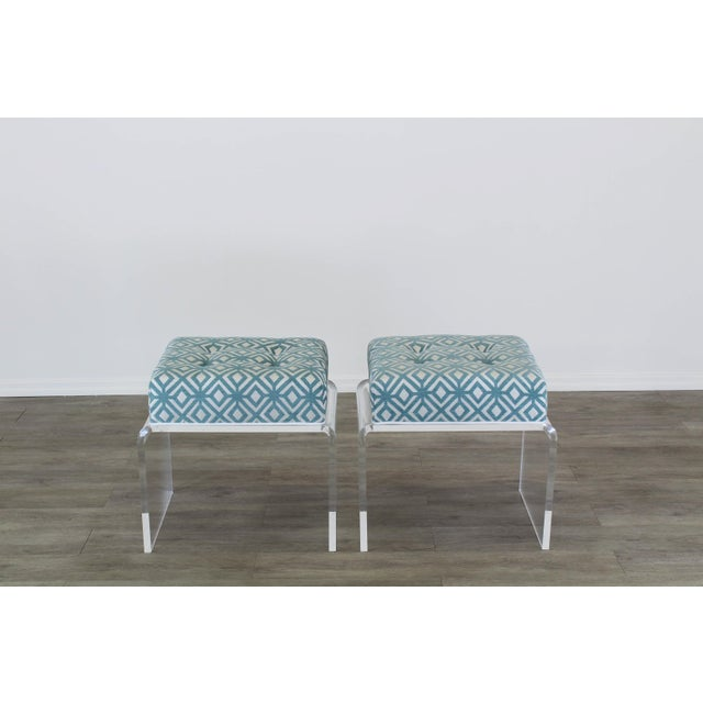 Elegant pair of custom waterfall acrylic benches with upholstered cushions in a luxurious geometric chenille textile Each...