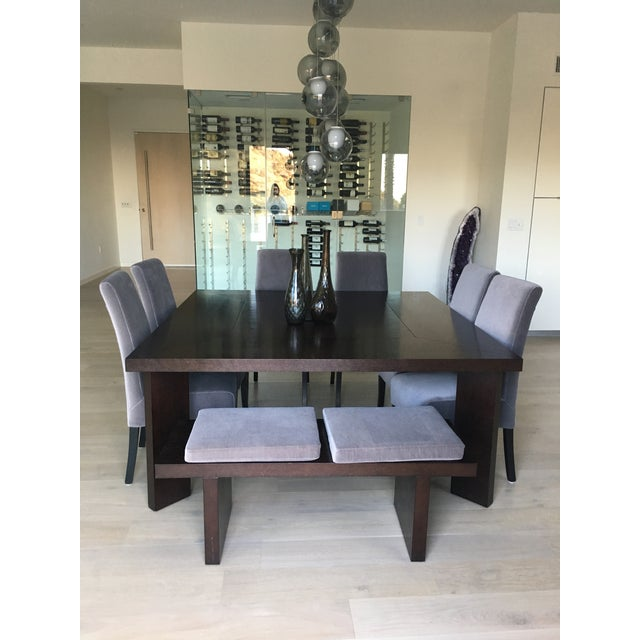 """Modern table, clean lines and seating for 8. Beautiful dark wood table is 66"""" square 29"""" high. Seating is upholstered in..."""