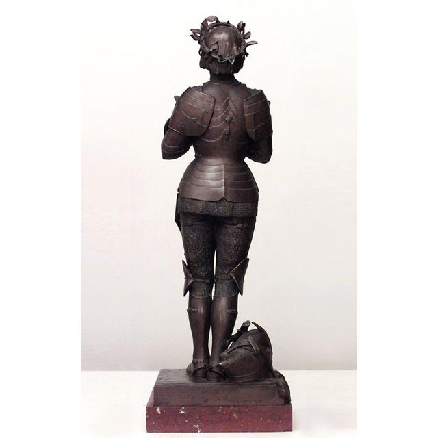 19th century French patinated metal figure of Joan of Arc standing on a rectangular rouge marble base, by Marius-Jean-...