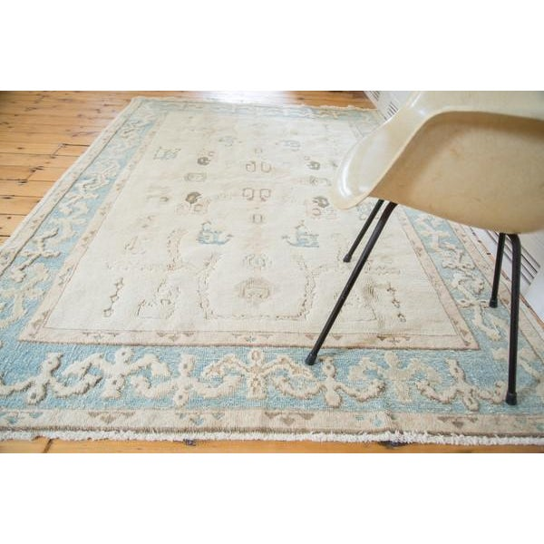 A unique Oushak of vintage character and great aesthetic. Unusual and unique Pale aqua blue border with reciprocating...