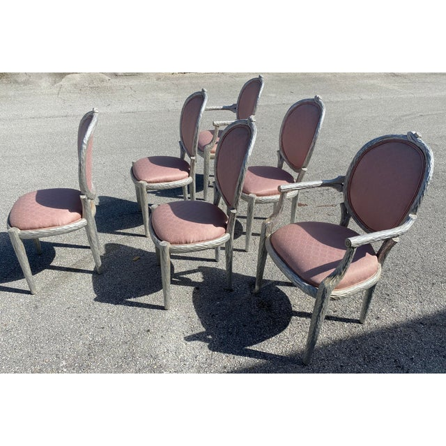 French Provincial (20th century) silver leaf dining chairs carved tree trunk, branch design having an oval upholstered...