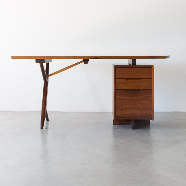 A conoid cross-legged desk in American walnut and hickory by George Nakashima, New Hope, 1963. A rare, stunning example of...