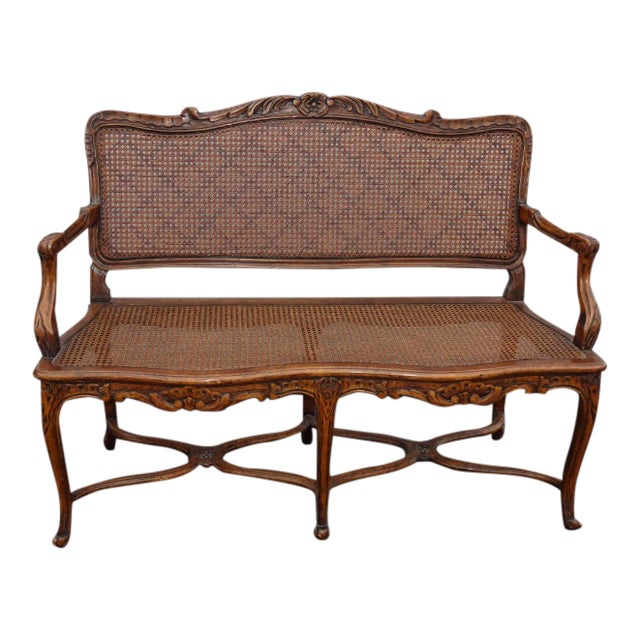 Vintage Martin of London French Country Brown Ornately Carved Cane Settee For Sale