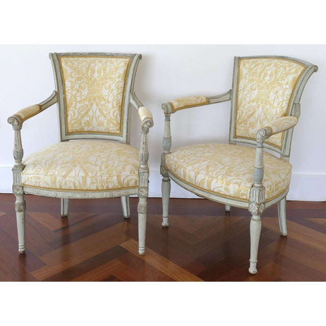 Antique Swedish painted armchairs, upholstered in Fortuny fabric Offered for sale is a married pair of antique Swedish...