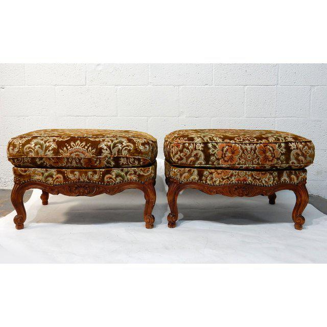 This is a beautiful matching pair of French Ottomans in solid wood frames with fabric upholstery. Please Note the nice...