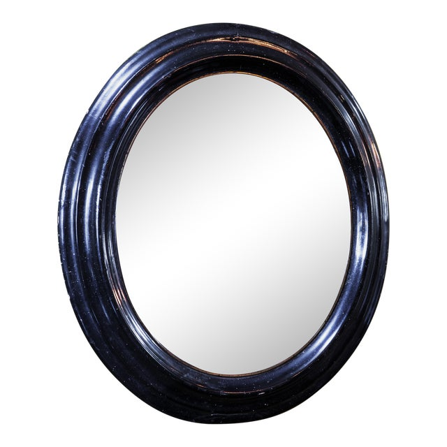 19th Century French Black and Gold Oval Ebonized Mirror For Sale