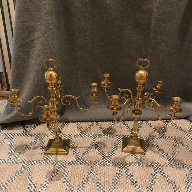 Vintage Heavyweight large scale pair of brass candelabras. Gorgeous design and craftsmanship. Nice weight and gorgeous...