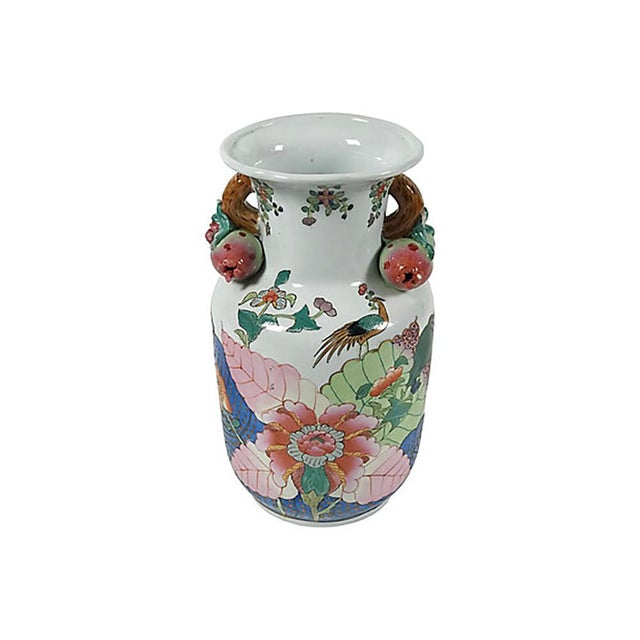 Ceramic urn in the Tobacco Leaf pattern. Multicolored leaves frame a pink blossom with peacocks. Handles support...
