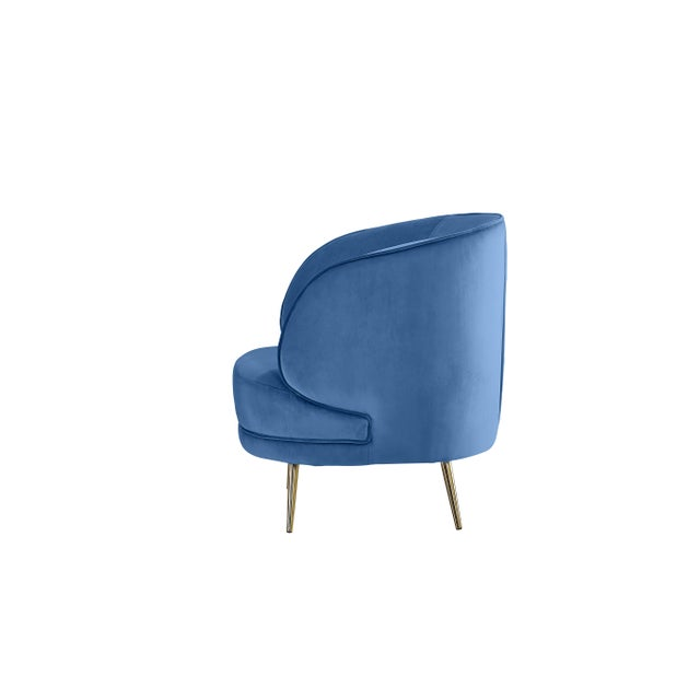Curved accent chair with blue velvet upholstery and gold metal legs. NO CUSTOM ORDERS. Sold as it is.