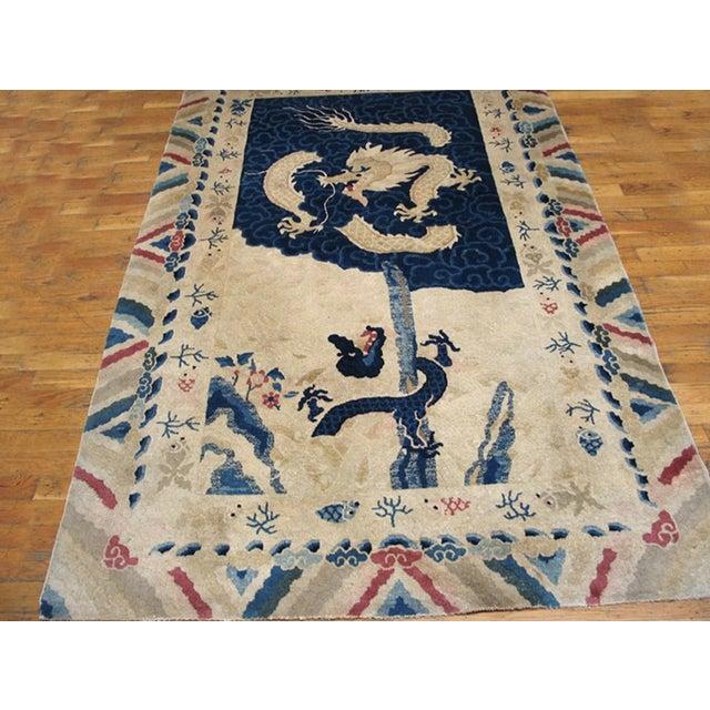Antique Chinese Peking Rug with an ivory background.
