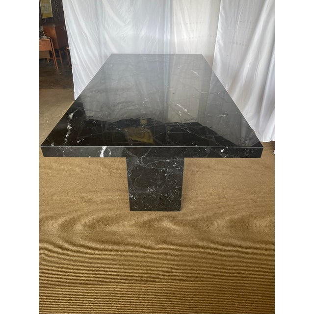 Gorgeous Nero marquina dining table from Italy. It is made of sections of marble filled in with tiny pieces and ground...